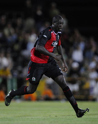 VILA REAL DE SANTO ANTONIO, PORTUGAL - JULY 26: Christopher Samba of Blackburn Rovers runs during the Guadiana Tournament match between Blackburn Rovers and Sporting Lisbon at the Vila Real De Santo Antonio stadium on July 26, 2008 in Vila Real De Santo A
