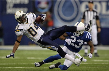 INDIANAPOLIS - JANUARY 13:  Buster Davis #84 of the San Diego Chargers makes a reception for a first down against Tim Jennings #23 of the Indianapolis Colts against the San Diego Chargers during their AFC Divisional Playoff game at the RCA Dome on January