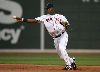 BOSTON - OCTOBER 07:  Shortstop Edgar Renteria #3 of the Boston Red Sox throws to first base for an out against the Chicago White Sox during Game Three of the American League Division Series at Fenway Park on October 7, 2005 in Boston, Massachusetts.  (Ph