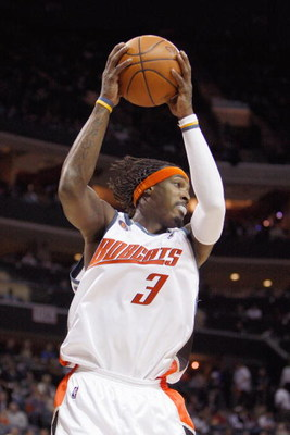 CHARLOTTE, NC - MARCH 13:  Gerald Wallace #3 of the Charlotte Bobcats rebounds the ball against the Houston Rockets during their game at Time Warner Cable Arena on March 13, 2009 in Charlotte, North Carolina. NOTE TO USER: User expressly acknowledges and