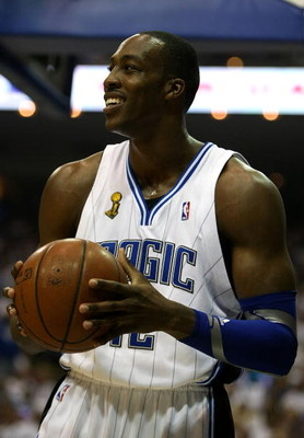 ORLANDO, FL - JUNE 14:  Dwight Howard #12 of the Orlando Magic smiles in the first half against the Los Angeles Lakers in Game Five of the 2009 NBA Finals on June 14, 2009 at Amway Arena in Orlando, Florida.  NOTE TO USER:  User expressly acknowledges and