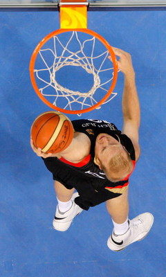 BEIJING - AUGUST 18:   Chris Kaman #12 of Germany dunks over the defense of the United States during the men?s basketball preliminaries at the Wukesong Indoor Stadium on Day 10 of the Beijing 2008 Olympic Games on August 18, 2008 in Beijing, China.  (Phot