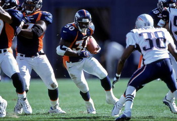 1 Oct 2000: Terrell Davis #30 of the Denver Broncos carries the ball during a game against the New England Patriots at the Mile High Stadium in Denver, Colorado. The Patriots defeated the Broncos 28-19.Mandatory Credit: Brian Bahr  /Allsport