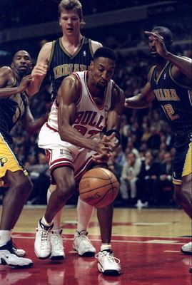 13 Apr 1998:  Scottie Pippen #33 of the Chicago Bulls is guarded by Dale Davis (L), Rik Smits #45 (C), and Derrick McKey (R) of the Indiana Pacers during a game at the United Center in Chicago, Illinois. The Pacers defeated the Bulls 114-105. Mandatory Cr