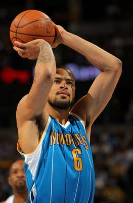 DENVER - APRIL 22:  Tyson Chandler #6 of the New Orleans Hornets takes a free throw against the Denver Nuggets in Game Two of the Western Conference Quarterfinals during the 2009 NBA Playoffs at Pepsi Center on April 22, 2009 in Denver, Colorado. The Nugg