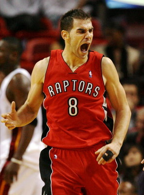 MIAMI - NOVEMBER 19:  Jose Calderon #8 of the Toronto Raptors celebrates after making a basket against the Miami Heat at American Airlines Arena on November 19, 2008 in Miami, Florida. The Raptors defeated the Heat 101-95. NOTE TO USER: User expressly ack