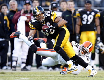 PITTSBURGH - DECEMBER 28:  Hines Ward #86 of the Pittsburgh Steelers escapes the tackle of Eric Wright #24 of the Cleveland Browns after a fourth quarter catch at Heinz Field December 28, 2008 in Pittsburgh, Pennsylvania. Pittsburgh won the game 31-0. (Ph