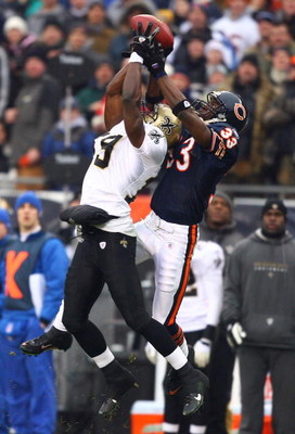 CHICAGO - JANUARY 21:  Devery Henderson #19 of the New Orleans Saints makes a 40-yard reception in the first quarter against Charles Tillman #33 of the Chicago Bears during the NFC Championship Game January 21, 2007 at Soldier Field in Chicago, Illinois.