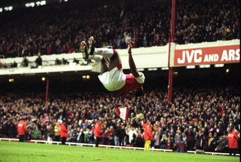 18 Apr 1998:  Christopher Wreh of Arsenal celebrates scoring a goal by showing off his gymnastic skills during the match between Arsenal v Wimbledon in the FA Carling Premiership played at Highbury, London, England. Arsenal 5-0. \ Mandatory Credit: Allspo
