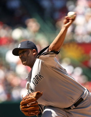 ANAHEIM, CA - JULY 12:  Pitcher C.C. Sabathia #52 of the New York Yankees throws a pitch against the Los Angeles Angels of Anaheim on July 12, 2009 at Angel Stadium in Anaheim, California. The Angels won 5-4.  (Photo by Stephen Dunn/Getty Images)