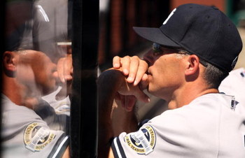 ANAHEIM, CA - JULY 12:  Manager Joe Girardi of the New York Yankees is reflected in plexiglass as he looks on from the dugout during the game with the Los Angeles Angels of Anaheim on July 12, 2009 at Angel Stadium in Anaheim, California.  The Angels won