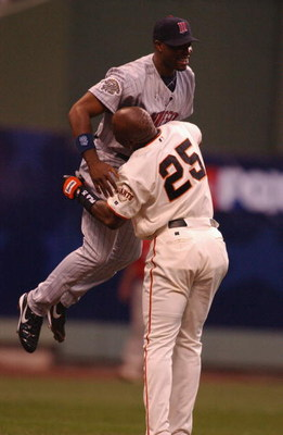 MILWAUKEE, WI - JULY 9: Barry Bonds #25 of the National league lifts Toril Hunter #48 of the American League after Hunter caught a ball hit by Bonds to the wall in the first inning during the MLB All Star Game July 9, 2002 at Miller Park in Milwaukee, Wis