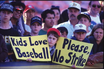 OAKLAND, CA - AUGUST 11:  Fan holds up a sign in protest of the baseball strike during a game between the Seattle Mariners and the Oakland Athletics at the Oakland Coliseum in Oakland, California.  The Mariners won the game 8-1. (Photo by Otto Greule/Gett