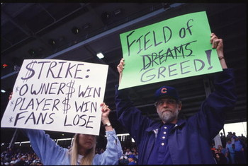CHICAGO - AUGUST 10:  Fans hold up signs in protest of the baseball strike during a game between the San Francisco Giants and the Chicago Cubs at Wrigley Field in Chicago, Illinios.  The Giants won the game 5-2.(Photo by Jonathan Daniel/Getty Images)