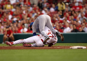 ST. LOUIS - JUNE 20:  Fernando Cortez #30 of the Kansas City Royals collides with starting pitcher Todd Wellemeyer #37 of the St. Louis Cardinals at first base during the 4th inning of the game on June 20, 2007 at Busch Stadium in St. Louis, Missouri.  (P