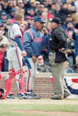 2 Apr 2001:  Head Coach Felipe Alou and Michael Barrett #5 of the Montreal Expos discuss a questionable call with Umpire Rick Reed during the Opening Day game against the Chicago Cubs at Wrigley Field in Chicago, Illinois.  The Expos defeated the Cubs 5-4