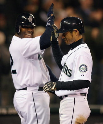 SEATTLE - APRIL 15:  Ichiro Suzuki (R) of the Seattle Mariners is congratulated by Ken Griffey, Jr. after hitting a grand slam against the Los Angeles Angels of Anaheim at Safeco Field April 15, 2009 in Seattle, Washington. The hit tied Suzuki with Isao H