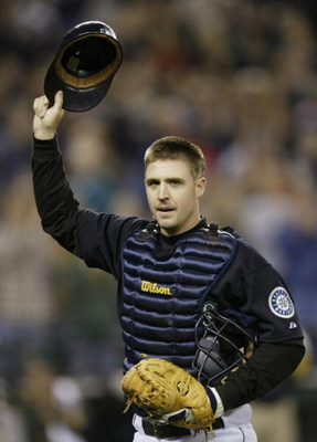 SEATTLE - SEPTEMBER 30:  Catcher Dan Wilson #6 of the Seattle Mariners acknowledges the crowd after coming out of the game against the Oakland Athletics in the second inning on September 30, 2005 at Safeco Field in Seattle, Washington. Wilson came back fr