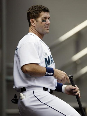 SEATTLE - AUGUST 14:  Designated hitter Edgar Martinez #11 of the Seattle Mariners watches the game against the New York Yankees at Safeco Field on August 14, 2004 in Seattle, Washington.  The Yankees won 6-4.  (Photo by Otto Greule Jr/Getty Images)