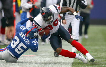 EAST RUTHERFORD,NJ - NOVEMBER 5: Andre Johnson #80 of the Houston Texans grips the ball as he is tackled by Kevin Dockery #35 of the New York Giants on November 5, 2006 at Giants Stadium in East Rutherford, New Jersey. (Photo by: Al Bello/Getty Images)