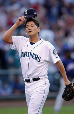 SEATTLE - MAY 25:  Kazuhiro Sasaki#22 of the Seattle Mariners walks on the field during the game aganist the Minnesota Twins on May 25, 2003 at Safeco Field in Seattle, Washington.  The Twins defeated the Mariners 3-1. (Photo by Otto Greule Jr./Getty Imag