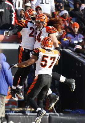 CLEVELAND - DECEMBER 21:  Leon Hall #29 of the Cincinnati Bengals celebrates his first quarter interception he returned for a touchdown with teammates Dhani Jones #57 and Domata Peko #94 while playing the Cleveland Browns at Cleveland Browns Stadium Decem