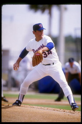 1992:  Pitcher Nolan Ryan of the Texas Rangers winds up for the pitch during spring training. Mandatory Credit: Jonathan Daniel  /Allsport