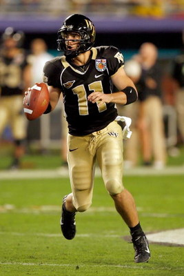 MIAMI GARDENS, FL - JANUARY 02:  Riley Skinner #11 of the Wake Forest Demon Deacons looks to pass against the Louisville Cardinals during the 2007 FedEx Orange Bowl at Dolphin Stadium on January 2, 2007 in Miami Gardens, Florida.  (Photo by Eliot J. Schec