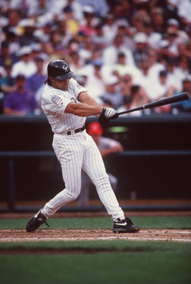 14 Jun 1995: Outfielder Dante Bichette of the Colorado Rockies focuses on the ball as he attempts to make contact during an at-bat in the Rockies 10-4 victory over the Cincinnati Reds at Coors Field in Denver, Colorado.