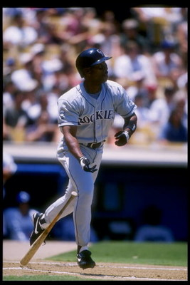 8 Jul 1996:  Center fielder Ellis Burks of the Colorado Rockies watches his shot during a game against the Los Angeles Dodgers at Dodger Stadium in Los Angeles, California.  The Rockies won the game 3-0. Mandatory Credit: Jed Jacobsohn  /Allsport