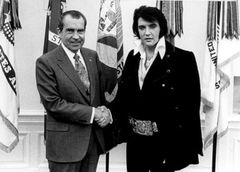 FILE PHOTO: President Richard Nixon meets with Elvis Presley December 21, 1970 at the White House. (Photo by National Archives)