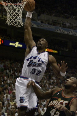 24 Apr 2000:   Karl Malone #32 of the Utah Jazz dunks on Vin Baker #42 of the Seattle Sonics during game 2 of the Western Conference NBA Playoffs at the Delta Center in Salt Lake City, Utah. DIGITAL IMAGE. Mandatory Credit: Jed Jacobsohn/ALLSPORT
