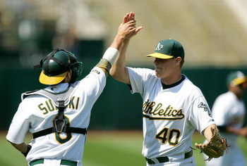 OAKLAND, CA - JUNE 07:  Kurt Suzuki #8 of the Oakland Athletics congratulates relief pitcher Andrew Bailey #40 after the Athletics beat the Baltimore Orioles at the Oakland Coliseum on June 7, 2009 in Oakland, California.  (Photo by Ezra Shaw/Getty Images