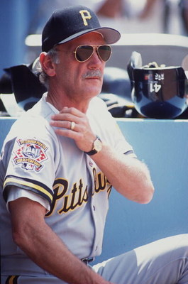 29 MAY 1994:  JIM LEYLAND, MANAGER OF THE PITTSBURGH PIRATES, GIVES A SIGN FROM THE DUGOUT DURING HIS TEAM''S GAME AGAINST THE DODGERS AT DODGER STADIUM IN LOS ANGELES, CALIFORNIA. Mandatory Credit: J.D. Cuban/ALLSPORT