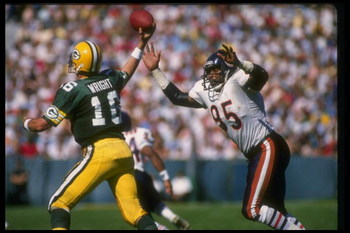 25 Sep 1988:  Defensive lineman Richard Dent of the Chicago Bears (right) goes after quarterback Randy Wright of the Green Bay Packers during a game at Lambeau Field in Green Bay, Wisconsin.  The Bears won the game, 24-6. Mandatory Credit: Jonathan Daniel
