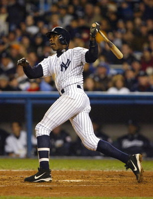 BRONX, NY - OCTOBER 19:  Alfonso Soriano #12 of the New York Yankees hits a two-run home run in the forth inning against the Florida Marlins during game 2 of the Major League Baseball World Series on October 19, 2003 at Yankee Stadium in the Bronx, New Yo