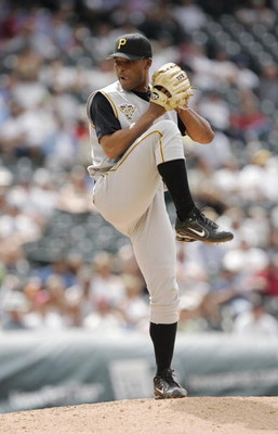 DENVER - JUNE 7:  Relief pitcher Damaso Marte #43 of the Pittsburgh Pirates throws against the Colorado Rockies on June 7, 2006 at Coors Field in Denver, Colorado. The Rockies won 16-9.  (Photo by Brian Bahr/Getty Images)