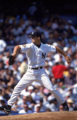 23 Apr 2001:  Ted Lilly #61 of the New York Yankees winds back to pitch the ball during the game against the Boston Red Sox at Yankee Stadium in Bronx, New York. The Yankees defeated the Red Sox 4-3.Mandatory Credit: Harry How  /Allsport