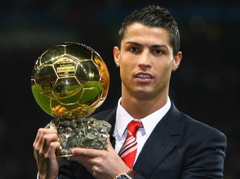 MANCHESTER, UNITED KINGDOM - DECEMBER 10:  Cristiano Ronaldo of Manchester United receives the Ballon d'or after being voted the European Footballer of the Year before the UEFA Champions League Group E match between Manchester United and Aalborg at Old Tr