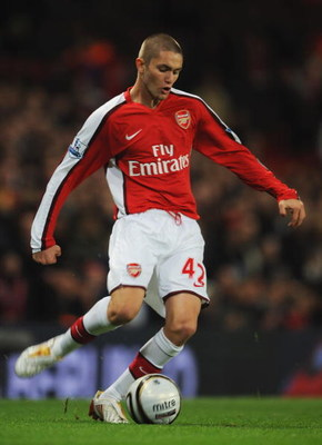LONDON - NOVEMBER 11:  Henri Lansbury of Arsenal passes the ball during the Carling Cup fourth round match between Arsenal and Wigan Athletic at the Emirates Stadium on November 11, 2008 in London, England.  (Photo by Shaun Botterill/Getty Images)