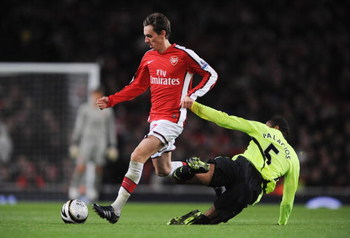 LONDON - NOVEMBER 11:  Mark Randall (L) of Arsenal is tackled by Wilson Palacios of Wigan during the Carling Cup fourth round match between Arsenal and Wigan Athletic at the Emirates Stadium on November 11, 2008 in London, England.  (Photo by Shaun Botter