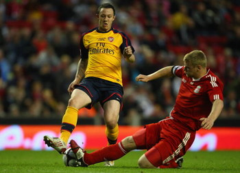 LIVERPOOL, ENGLAND - MAY 26:  Joe Kennedy of Liverpool tackles Rhys Murphy of Arsenal during the second leg of the FA Youth Cup final sponsored by E.ON, between Liverpool and Arsenal at Anfield on May 26, 2009 in Liverpool, England.  (Photo by Jamie McDon