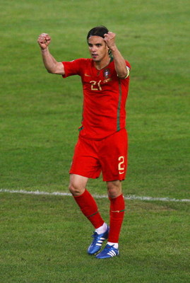 BASEL, SWITZERLAND - JUNE 19: Nuno Gomes of Portugal celebrates after scoring his teams first goal during the UEFA EURO 2008 Quarter Final match between Portugal and Germany at St. Jakob-Park on June 19, 2008 in Basel, Switzerland.  (Photo by Shaun Botter
