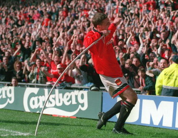 12 MAR 1995:  LEE SHARPE OF MANCHESTER UNITED CELEBRATES BY MAKING A SONG AND DANCE AFTER SCORING UNITEDS FIRST GOAL AGAINST QUEENS PARK RANGERS IN THE SIXTH ROUND OF THE FA CUP AT OLD TRAFFORD, MANCHESTER. Mandatory Credit: Shaun Botterill/ALLSPORT