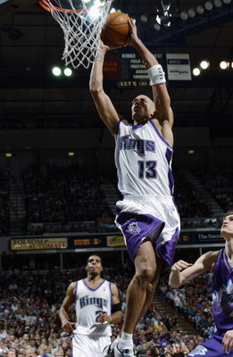 SACRAMENTO, CA - APRIL 16:  Doug Christie #13 of the Sacramento Kings dunks against the Utah Jazz during the game at Arco Arena on April 16, 2003 in Sacramento, California.  The Kings won 95-84.  NOTE TO USER: User expressly acknowledges and agrees that,