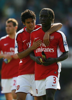PORTSMOUTH, UNITED KINGDOM - MAY 02:  Carlos Vela of Arsenal and Bacary Sagna of Arsenal celebrate victory following the Barclays Premier League match between Portsmouth and Arsenal at Fratton Park on May 2, 2009 in Portsmouth, England.  (Photo by Paul Gi