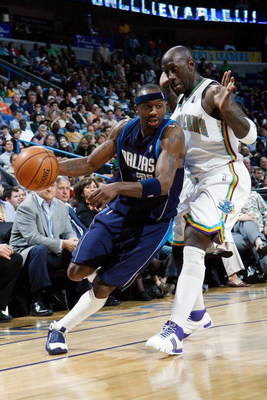 NEW ORLEANS - FEBRUARY 20:  Jason Terry #31 of the Dallas Mavericks drives the ball around Bobby Jackson #8 of the New Orleans Hornets on February 20, 2008 at the New Orleans Arena in New Orleans, Louisiana.  The Hornets defeated the Mavericks 104-93.  NO