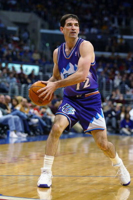 LOS ANGELES - APRIL 1:  John Stockton #12 of the Utah Jazz looks to pass during the game against the Los Angeles Clippers at Staples Center on April 1, 2003 in Los Angeles, California.  The Jazz won 94-89.  NOTE TO USER: User expressly acknowledges and ag