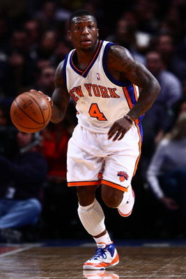 NEW YORK - JANUARY 23:  Nate Robinson #4 of the New York Knicks dribbles upcourt during the game against the Memphis Grizzlies at Madison Square Garden January 23, 2009 in New York City. NOTE TO USER: User expressly acknowledges and agrees that, by downlo