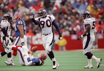 26 Oct 1997:  Defensive lineman Neil Smith of the Denver Broncos celebrates during a game against the Buffalo Bills at Rich Stadium in Orchard Park, New York.  The Broncos won the game, 23-20. Mandatory Credit: Rick Stewart  /Allsport
